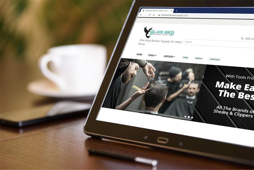 Black Bird Barber Supply website on a tablet device in a barber shop break room.